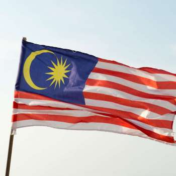 Close up of Malaysia flag flying in the sky