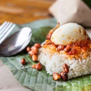 Simple authentic nasi lemak wrapped in banana leaf, popular breakfast in Malaysia